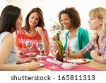 Group Of Women Sitting Around...