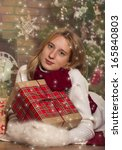 happy girl with presents near... | Shutterstock . vector #165840803