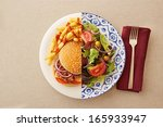 low fat healthy salad against...   Shutterstock . vector #165933947