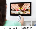 close up of a woman holding... | Shutterstock . vector #166287293