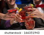 close up of hands with glasses  ... | Shutterstock . vector #166351943