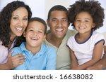 family in living room smiling | Shutterstock . vector #16638082