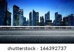 asphalt road and modern city | Shutterstock . vector #166392737