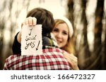 girlfriend saying yes to a... | Shutterstock . vector #166472327