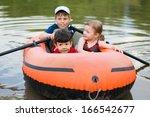 Three Children Float On A...
