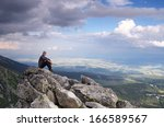 man tourist is sitting on a...   Shutterstock . vector #166589567