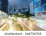 traffic in hong kong at night   Shutterstock . vector #166726763