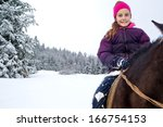 Little Girl Riding Horse In...