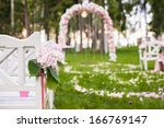 Wedding Benches And Flower Arc...
