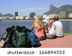 group of backpackers tourists... | Shutterstock . vector #166894553