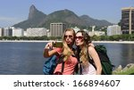 couple of female backpackers... | Shutterstock . vector #166894607