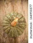 Gray Pumpkin On A Wooden...