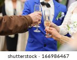 bride and groom clanging... | Shutterstock . vector #166986467