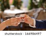 bride and groom clagning...   Shutterstock . vector #166986497