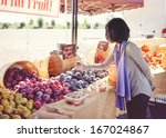 Woman Shopping For Fruit At An...