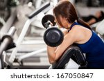 cute young woman working out by ... | Shutterstock . vector #167050847