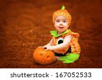 Halloween Child With Pumpkin...