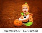 Halloween Child With Pumpkin...