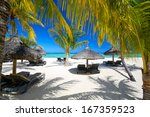 lounge chairs with umbrellas on ... | Shutterstock . vector #167359523