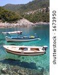 Small Fishing Boats Anchored A...