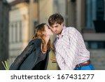 young woman kisses her boyfriend | Shutterstock . vector #167431277