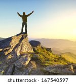 champion on the mountain top.... | Shutterstock . vector #167540597