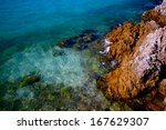 the rocks and blue sea | Shutterstock . vector #167629307