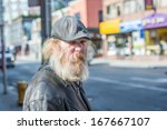 Small photo of TORONTO, ON, CANADA - OCTOBER 30: Homeless man wonder aimlessly alone on Young Street, in Toronto Canada on October 30, 2013