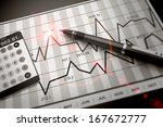 pen and calculator on stock... | Shutterstock . vector #167672777