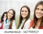 happy teen girls having good... | Shutterstock . vector #167704517