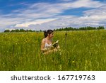 young woman reading book on a