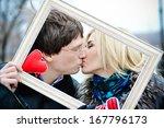 Couple Holding Decorative Fram...