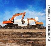 Excavator Working At...