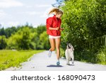 Stock photo young attractive sport girl running with dog in park 168090473
