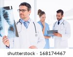 male doctor examining x ray... | Shutterstock . vector #168174467