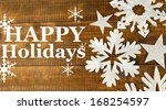 beautiful paper snowflakes on... | Shutterstock . vector #168254597