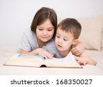 happy children is reading book | Shutterstock . vector #168350027