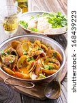 cataplana with clams | Shutterstock . vector #168439223