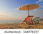 beach chairs with umbrella at... | Shutterstock . vector #168478157