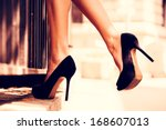 Woman Legs In High Heel Shoes...