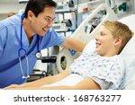 Boy Talking To Male Nurse In...
