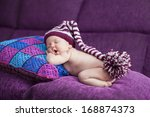 close up sleeping newborn  with ... | Shutterstock . vector #168874373