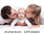 Closeup Of Young Family With...
