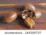 Pecans On A Wooden Board