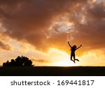 Small photo of Happy woman jumping against sunset. Freedom concept. Enjoyment.