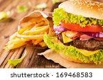 delicious hamburger on wood | Shutterstock . vector #169468583