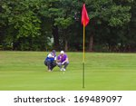 a professional golfer and his... | Shutterstock . vector #169489097