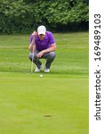 golfer holding his putter... | Shutterstock . vector #169489103