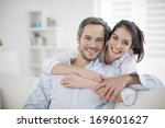 couple at home relaxing in sofa | Shutterstock . vector #169601627