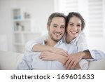 couple at home relaxing in sofa | Shutterstock . vector #169601633